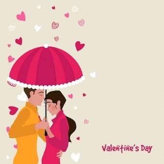 傘をさしかわいいカップルと美しい背景