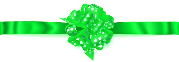 Beautiful big horizontal bow made of green ribbon with small shiny hearts with shadow on white background