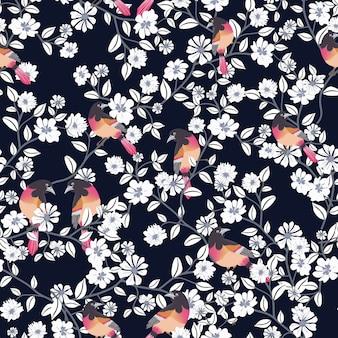 美しい鳥と白い花のシームレスなパターン。