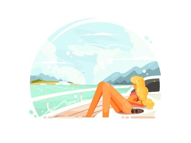 ヨットでリラックスして日光浴をしている美しいブロンドの女の子