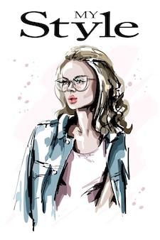 眼鏡の美しいブロンドの髪の少女