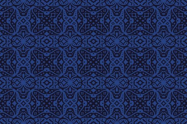 暗い背景に抽象的な星空のシームレスなパターンを持つ美しい青いベクトルの背景