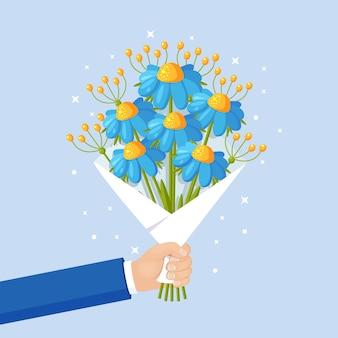 Красивый букет d на фоне. букет цветов для подарка в руке. для поздравительной открытки