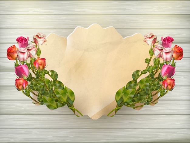 Beautiful bouquet of multicolored roses and a card of vintage cardboard on a wooden board, close-up, ready background.   file included