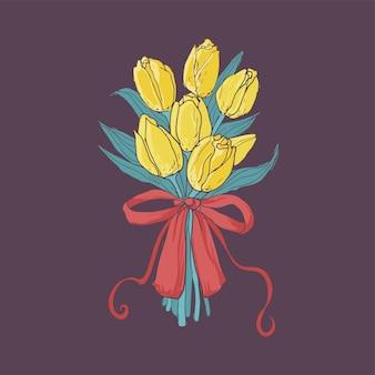 어둠에 우아한 빨간 리본으로 묶인 노란 튤립의 아름다운 꽃다발