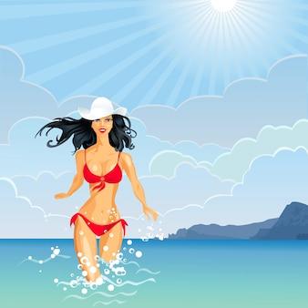 흰 모자와 빨간 수영복에 긴 머리를 가진 아름다운 갈색 머리 소녀가 바다에 들어갑니다