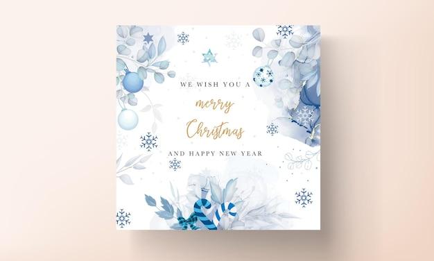 Bellissimo modello di biglietto di natale con ornamenti natalizi bianchi e blu