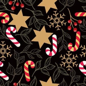 Bellissimo motivo natalizio senza cuciture con foglie d'oro e ornamento natalizio