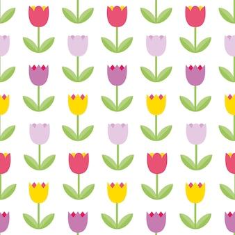 白い背景の上の美しい色のチューリップ。シームレスパターン。カラフルな花のパターン。母の日、3月8日、春のカード、夏のイラストに適したかわいい花の背景。