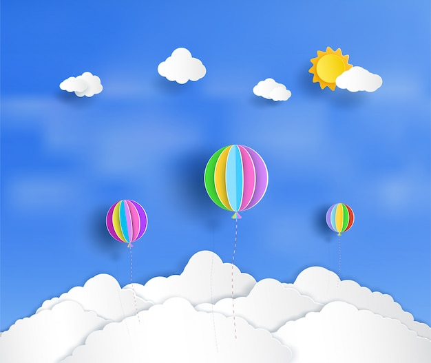 Beautiful and colorful balloons floating above the clouds.
