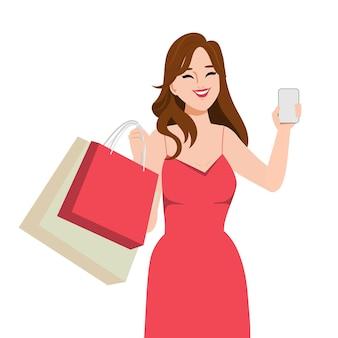 Красивая женщина покупателя делает покупки онлайн с мобильного телефона
