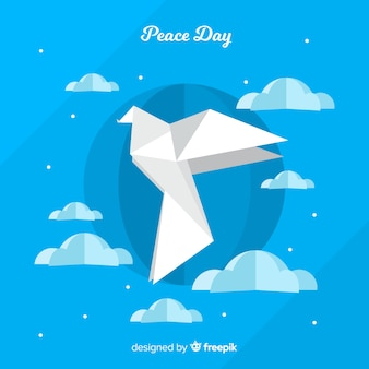 Beautiful day of peace background with paper pigeon