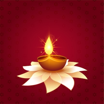 Beautiful diwali festival diya on flower background
