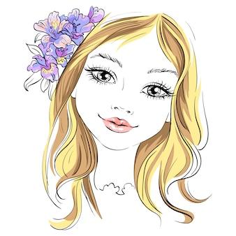 髪に花を持つ美しいファッションの少女