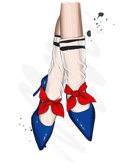 スタイリッシュな靴の美しい女性の脚。