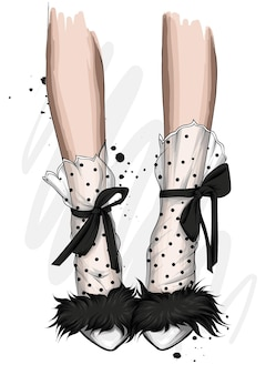 Beautiful female legs and stylish high-heeled shoes