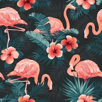 Beautiful flamingo bird and tropical flowers background
