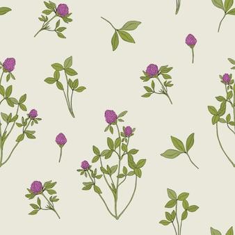 グレーにレッドクローバーと美しい花のシームレスなパターン