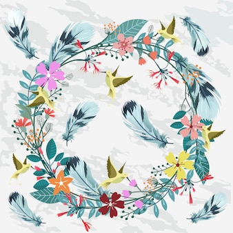 Beautiful floral wreath with feather and hummingbird.