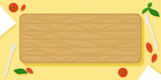 木製のまな板、チェリートマト、塩の結晶、カトラリーと美しい食べ物の背景。フラットの図。上からの眺め。