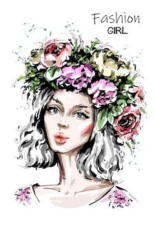 花の花輪の美しい森の少女。