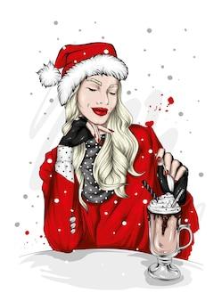 クリスマスの帽子とスタイリッシュな服を着た美しい少女