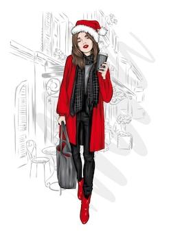 코트와 산타 클로스의 모자에서 아름 다운 소녀. 크리스마스.