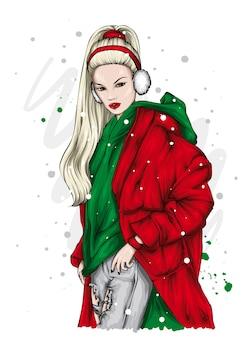 Красивая девушка в пальто и наушниках. рождество.
