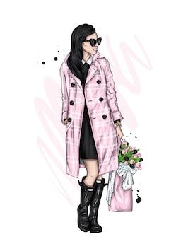 코트와 튤립에서 아름 다운 소녀