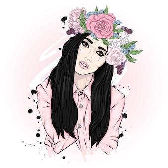 花の花輪の美しい少女