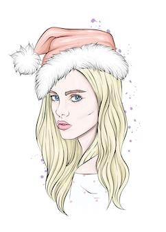 산타 클로스 모자에서 아름 다운 소녀