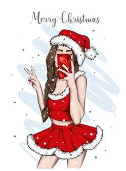 산타 모자에서 아름 다운 소녀입니다.