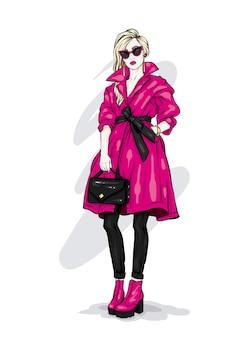 スタイリッシュなコートとメガネの美しい少女