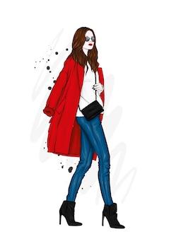 세련된 코트와 안경에 아름다운 소녀
