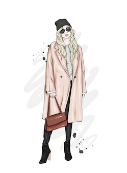 세련 된 코트와 모자에서 아름 다운 소녀