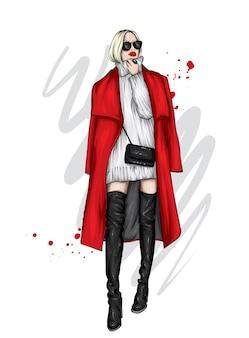 スタイリッシュなコートとハイブーツの美しい少女。眼鏡をかけたファッショニスタ。