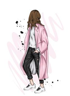 세련 된 코트와 신발에 아름 다운 소녀