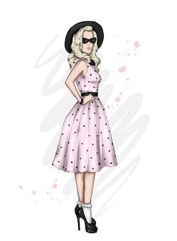 スタイリッシュなドレスと帽子の美しい少女