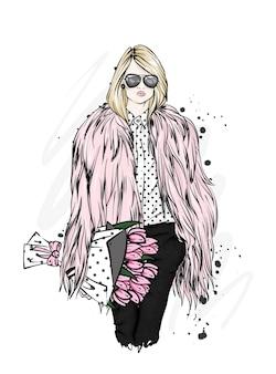 スタイリッシュな毛皮のコートを着た美しい少女