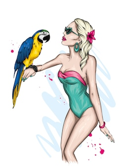 세련된 수영복과 앵무새와 함께 아름다운 소녀