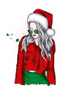 クリスマスの服と新年のサンタクロースの帽子の美しい少女
