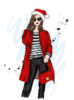 スタイリッシュな服とクリスマスの帽子の美しい少女