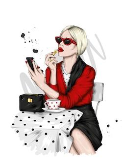 スタイリッシュな服と一杯のコーヒーの美しい少女