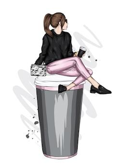 세련된 옷과 커피 한 잔에 아름다운 소녀 프리미엄 벡터