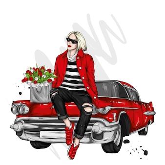세련 된 옷과 레트로 자동차에서 아름 다운 소녀