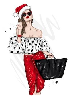 세련된 옷과 산타 클로스 모자에 아름다운 소녀