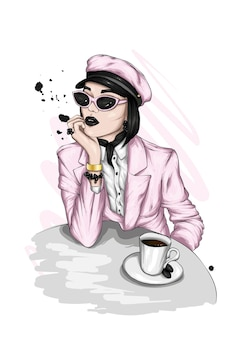 세련 된 옷과 커피에 아름 다운 여자