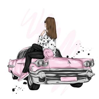 세련 된 옷과 빈티지 자동차에서 아름 다운 소녀