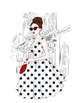 Красивая девушка в модной стильной одежде и стиле