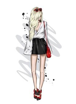세련 된 옷을 입고 아름 다운 소녀